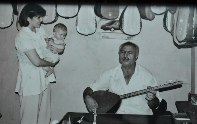 14 years ago, baby and me.  This kind man plays his Turkish Saz for us.