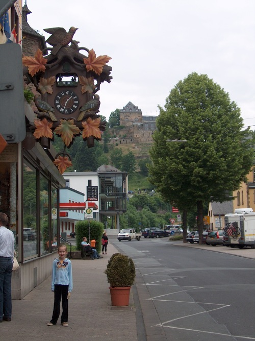 Giant Cuckoo Clock on the Rhine River in Germany--looking out on new shops and very old castles.