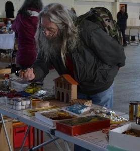 Our wizard friend shops the stalls of Diagon Alley. . . ur, Metz market.