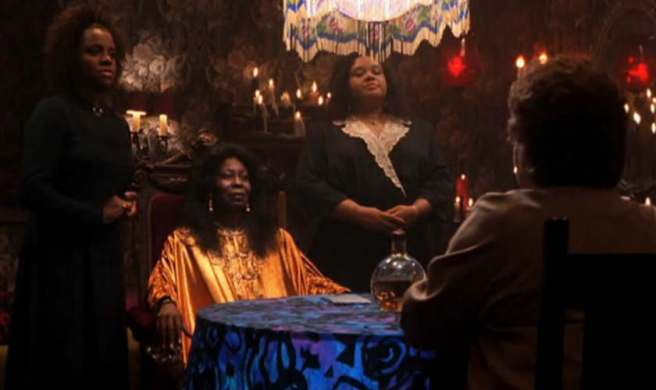 Whoopi Goldberg as Oda Mae, the psychic, in the movie Ghost.