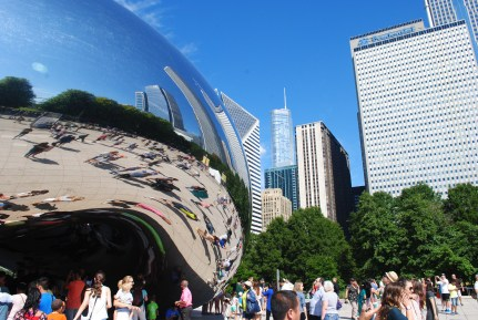 The Bean buildings vs the real buildings. One set swings with the jazz, the other stands tall and serious.